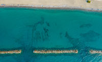 Aerial view from flying drone of people relaxing on the beach. Paphos Cyprus