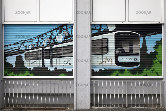Suspension railway painted on roller shutters in the center of Elberfeld, Wuppertal, Germany, Europe