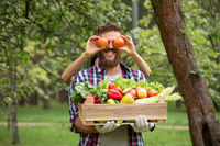 Farmer with apple as glasses