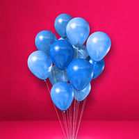 Blue balloons bunch on a pink wall background
