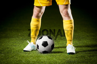 soccer ball and a feet of a soccer player