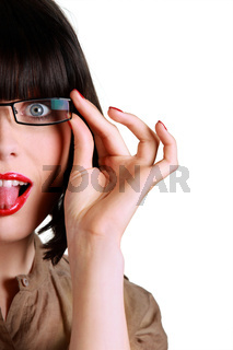 Woman with glasses sticking out her tongue