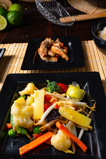 Fried vegetables from the wok with deep fried meat