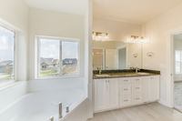 Contemporary masters bathroom with sliding windows in all white