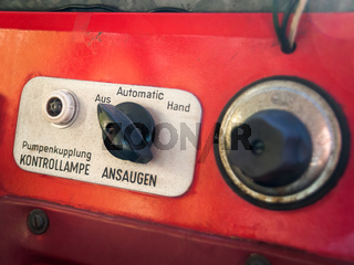 Instruments in german at the panel of an old off-road vehicle in color red