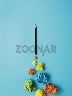 Launching pencil rocket with jet stream of paper balls, creativity concept or new ideas metaphor