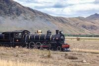 KINGSTON, NEAR LAKE WAKATIPU, NEW ZEALAND - FEBRUARY 17 : View of the Kingston Flyer steam train in Kingston  New Zealand on February 17, 2012. One unidentified person