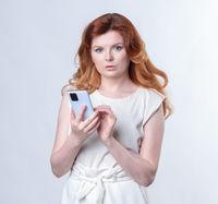Red-hair Model posing in studio