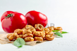 Taralli with tomatoes and herbs.