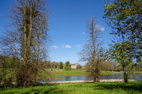 SWINDON, WILTSHIRE, UK -APRIL 25 : View of Lydiard Park showing a distant view of the Palladian house near Swindon Wiltshire on April 25, 2021. Unidentified people