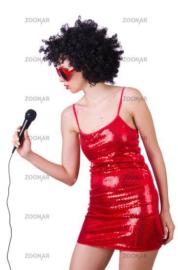 Pop star with mic in red dress on white