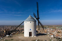 traditional whitewashed Spanish windmills in La Mancha on a hilltop above Consuegra
