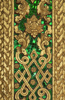 Gilded carvings and inlays of green glass, Haw Pha Bang temple, Luang Prabang, Laos