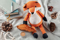 Hygge morning. A toy fox with an autumn leaf and some journal notebooks