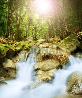 Beautiful waterfall in mountain wood, long exposure