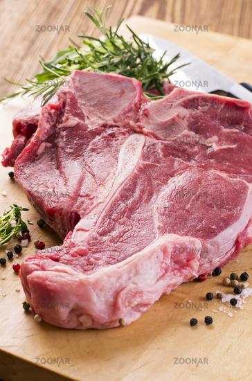 t-bone steak with herbs and pepper