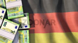 100 Euro-Scheine liegen auf Deutschland-Flagge