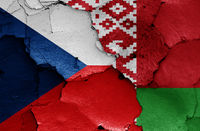 flags of Czechia and Belarus painted on cracked wall