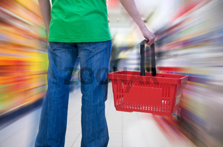 Customer in supermarket. Motion blur conceptual