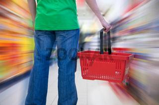 Customer in supermarket. Motion blur conceptual