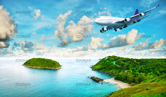 Jet liner over the tropical island. Panoramic comp