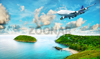 Jet liner over the tropical island