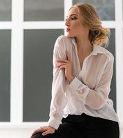 Pretty woman in sexy white shirt studio portrait