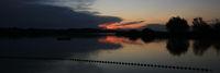 Sunset view from Auslikon, Wetzikon. Bright red sky and shore of Lake Pfaeffikon, Zurich Canton, Switzerland.