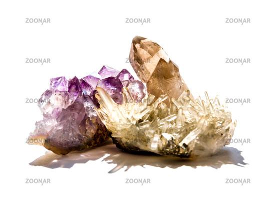 Amethyst and quartz gemstones on a white background