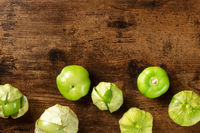 Tomatillos, green tomatoes, top shot with copy space. Mexican food