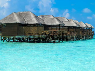 Row of luxury beach cottages over water