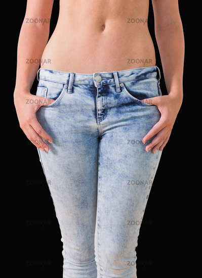Woman holding her jeans