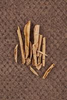 Sananga or Tabernaemontana sananho pile on brown background.