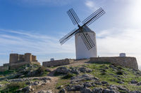 view of the windmills and castle of Consuegra in La Mancha in central Spain
