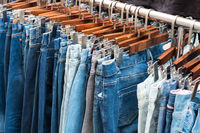 jeans on hangers, second hand clothing -