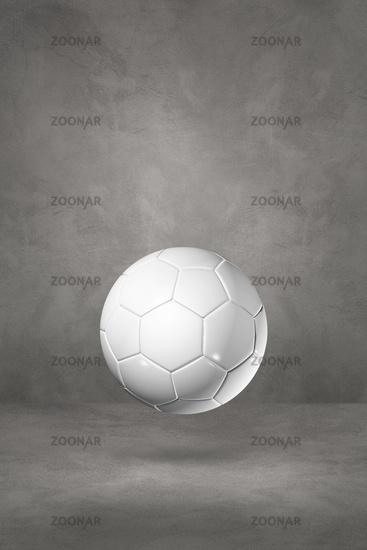 White soccer ball on a concrete studio background