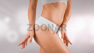 Beautiful woman body part with healthy skin. Young woman weared in white lingerie, isolated on light gray background with bokeh pattern. Healthcare and medical concept