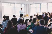 Speaker giving presentation on business conference event