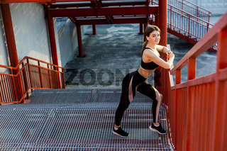 Young brunette woman and sport workout outdoor.
