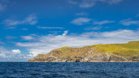 Bray Head coastline seen from Kerry Cliffs and blue waters of Atlantic Ocean