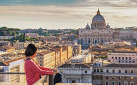 Rome Vatican Italy high angle view sunset city skyline with woman tourist