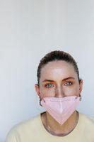 Portrait of a young woman wears face protect mask. Virus and pandemic.