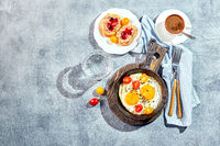 Fried eggs in cast-iron skillets. Sunny morning breakfast concept