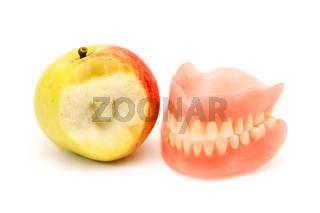 Denture and bitten apple