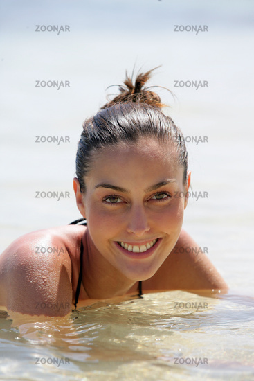 Attractive woman swimming