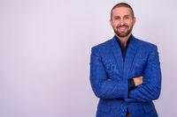 Portrait of happy handsome bald bearded businessman in suit