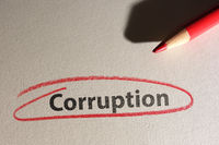 Corruption text circled in red pencil on texured paper
