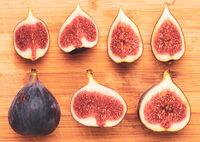 Fresh figs isolated on wooden background.