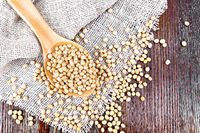 Soybeans in spoon on board top