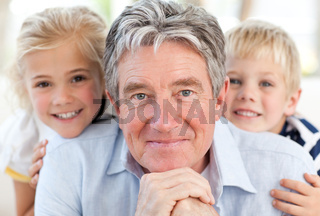 Joyfull little family looking at the camera